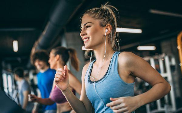 Woman running on a treadmill in health club